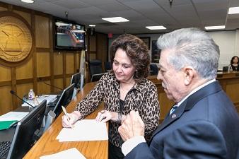 Board of Trustee, Dr. Barbara Mink swears in