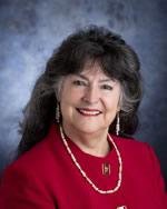 Dr. Nora de Hoyos Comstock