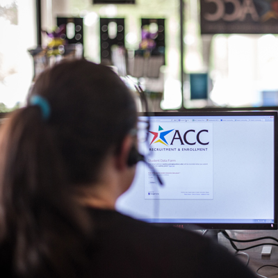 ACC employee sitting at a computer