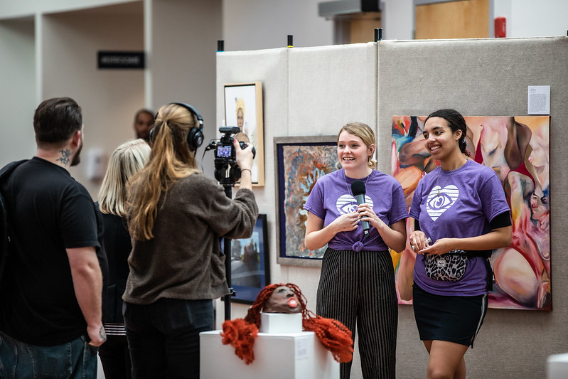 Artists discuss their work on display at National Day of Racial Healing.