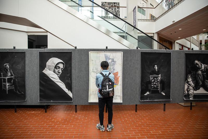 Guests view artwork on display.