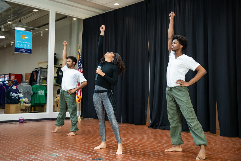 Leah Bouvier, Dmo Acheka and Marques Jackson perform song and dance.