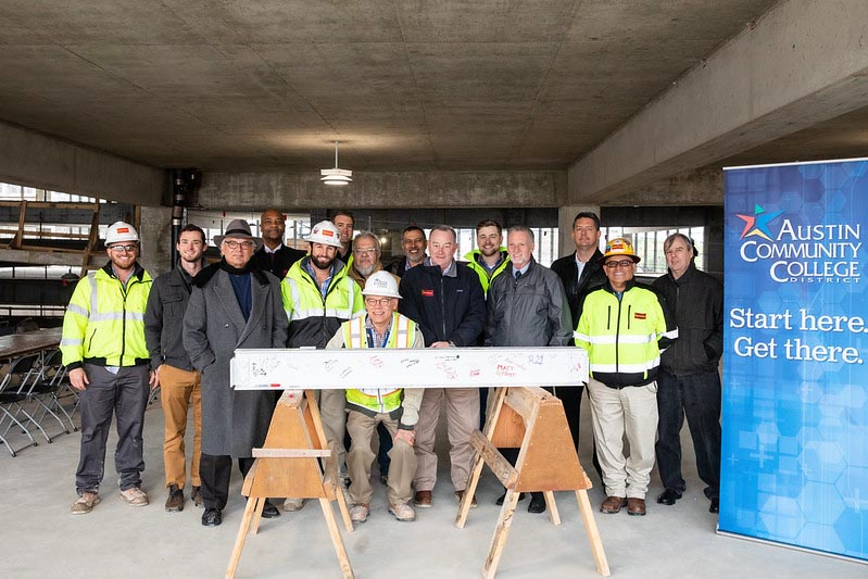Group photo of members of the construction team that worked on the Highland Campus Parking Garage and members of Austin Community College.