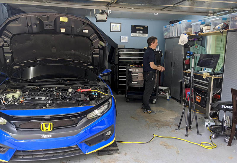 Dusty Mills, Automotive Technology associate professor, created videos for his classes in his garage.