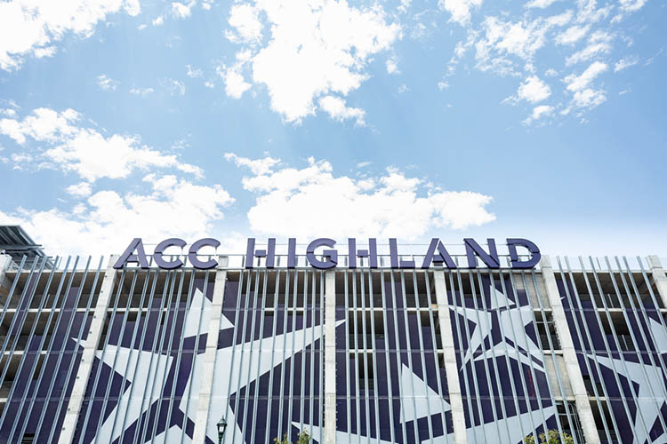 ACC Highland in large block letters installed on the East facing side of the Highland Campus parking garage.