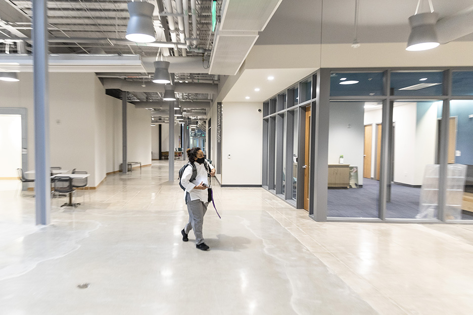 ACC Culinary Arts student Ora E. walks through Highland Campus, Building 2000 on her way to her first class of the spring 2021 semester, Meat Prep with Chef David Waggoner.