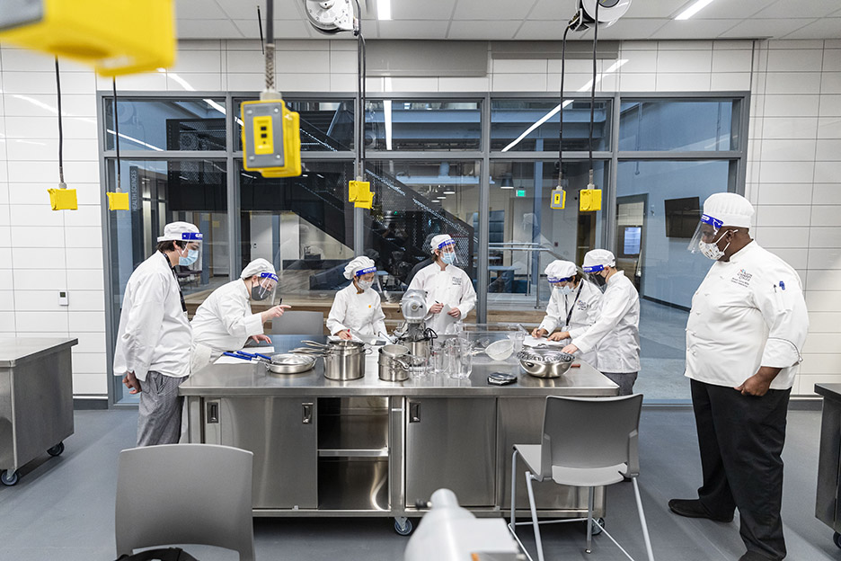 Chef Bryant Currie, right, teaches a Basic Food Prep class during the first day of spring 2021 semester inside the Demonstration Kitchen at the Highland Campus, Building 2000.