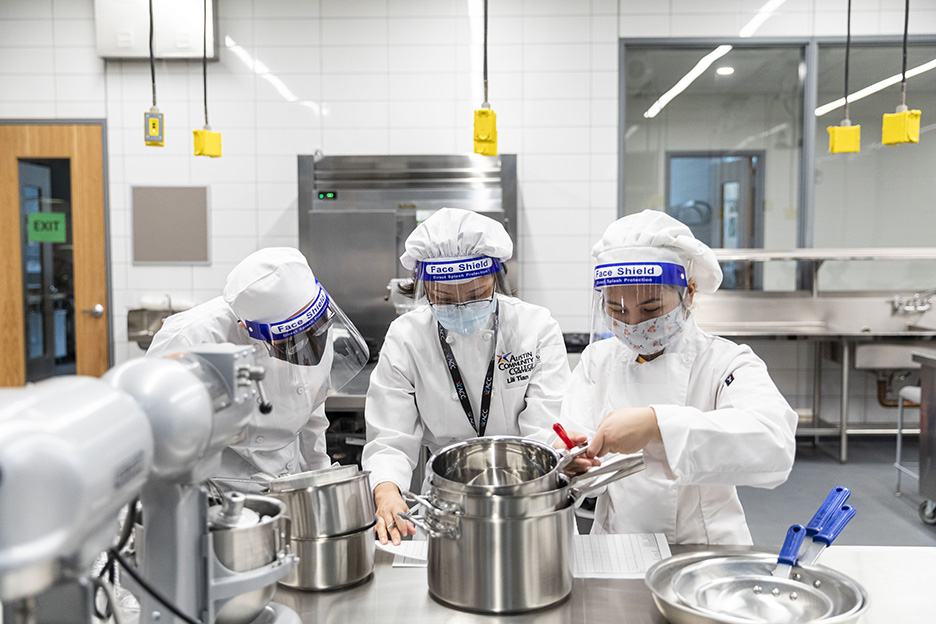 Students are introduced to professional kitchen utensils and pots during a Basic Food Prep class on the first day of spring 2021 semester inside the Demonstration Kitchen at the Highland Campus, Building 2000.
