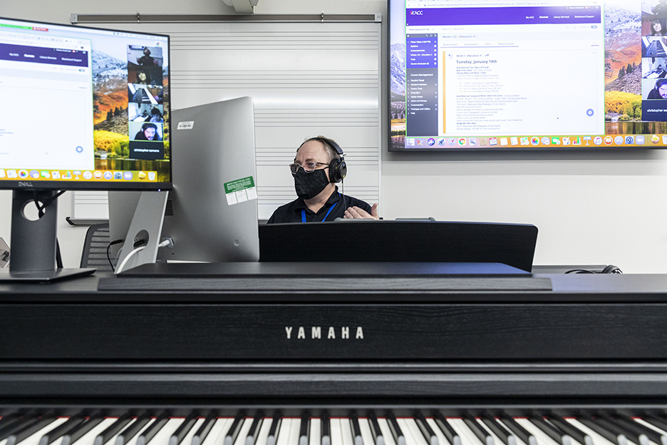 Shane Anderson, ACC Music Department chair and professor, teaches a hybrid piano class on the first day of the spring 2021 semester at the Highland Campus, Building 2000.