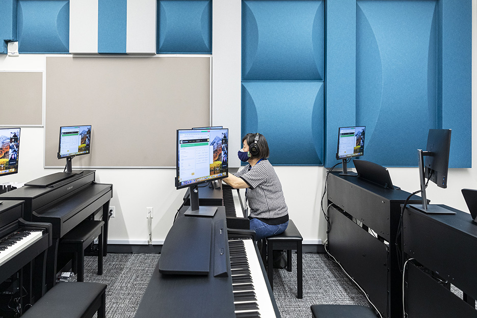 A student attends a hybrid piano class taught by Shane Anderson, ACC Music Department chair and professor, on the first day of the spring 2021 semester at the Highland Campus, Building 2000.