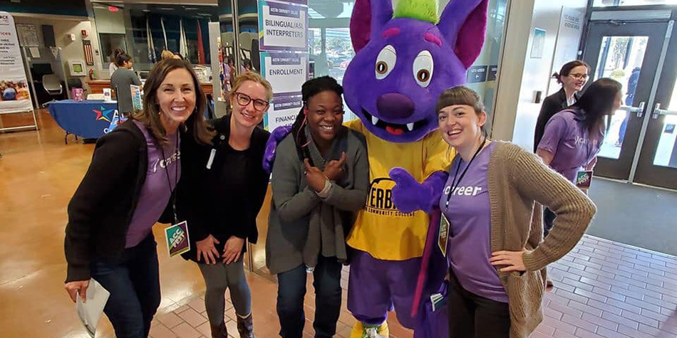 Attendees pose with ACC Mascot, R.B., at ACC Fest 2019.