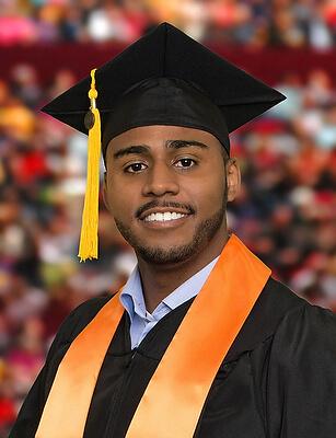 Male ACC graduate posing for portrait.