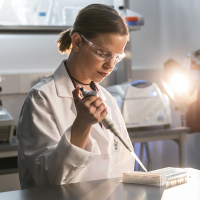 ACC student in the bioscience incubator conducting an experiment