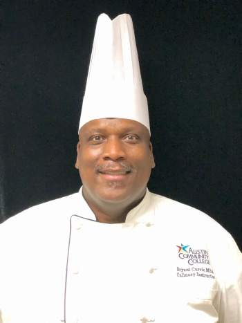 Bryant Currie with chef hat