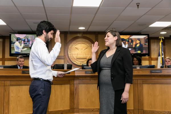 Newly elected trustee Stephanie Gharakhanian is sworn in by Austin City Council Member Gregorio Casar