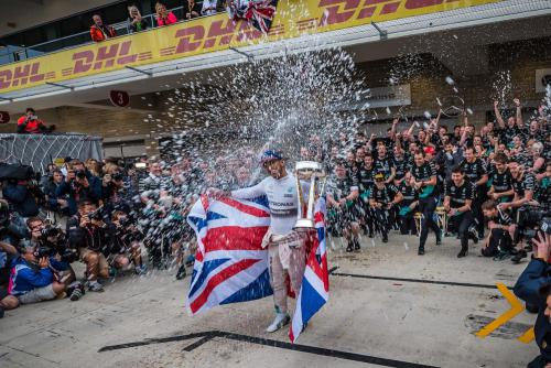 Lewis Hamilton celebrates winning the driver's championship at the 2015 Formual 1 race.