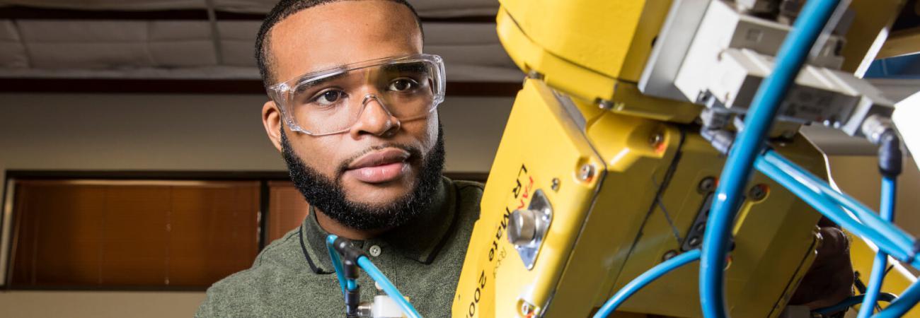 Advanced electronics student using machinery