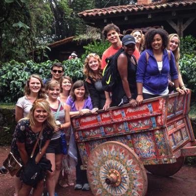 ACC students crowded around decorative rickshaw during study abroad trip