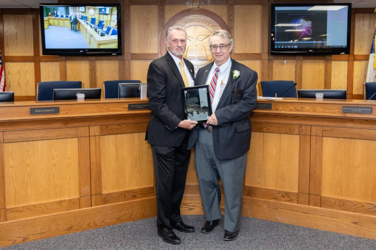 William Peck Young (right) being presented with a plaque for his retirement by ACC President/CEO Dr. Richard Rhodes