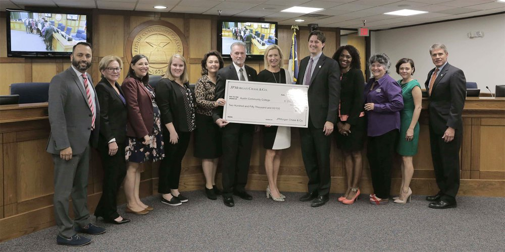 ACC Board of Trustees with a check from JP Morgan Chase.